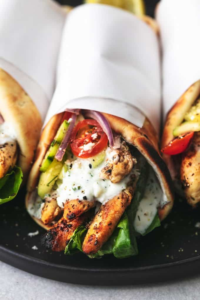 chicken gyro with tzatziki sauce and cucumber salad wrapped in papper