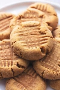 stacked peanut butter cookies on plate
