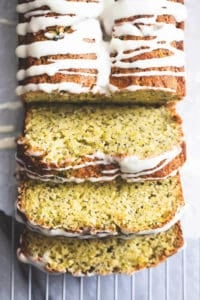 sliced loaf of poppy seed bread with glaze drizzled on top