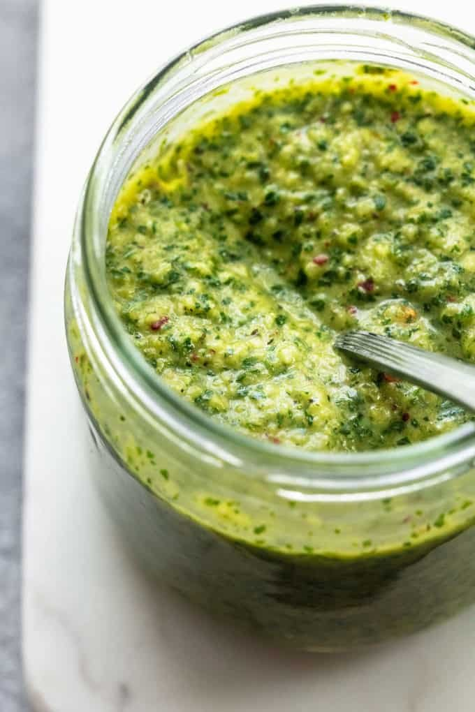 chimichurri sauce in jar with spoon