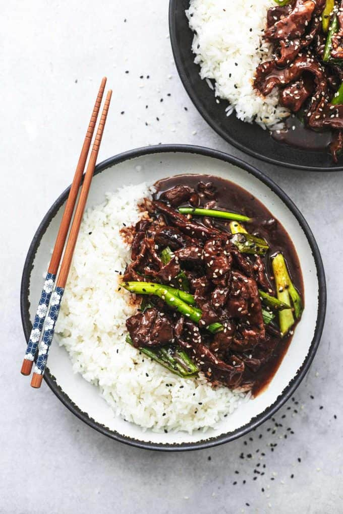 mongolian beef and white rice in bowl with chopsticks