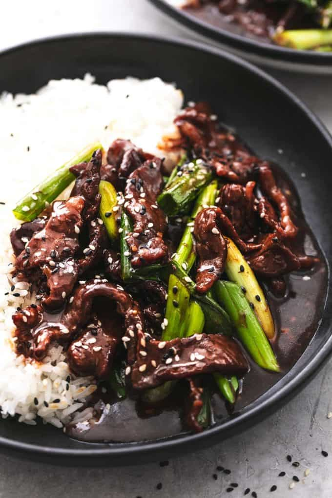 up close beef and green onions in sauce