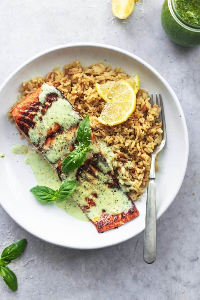 overhead view of salmon fillet with pesto sauce and orzo
