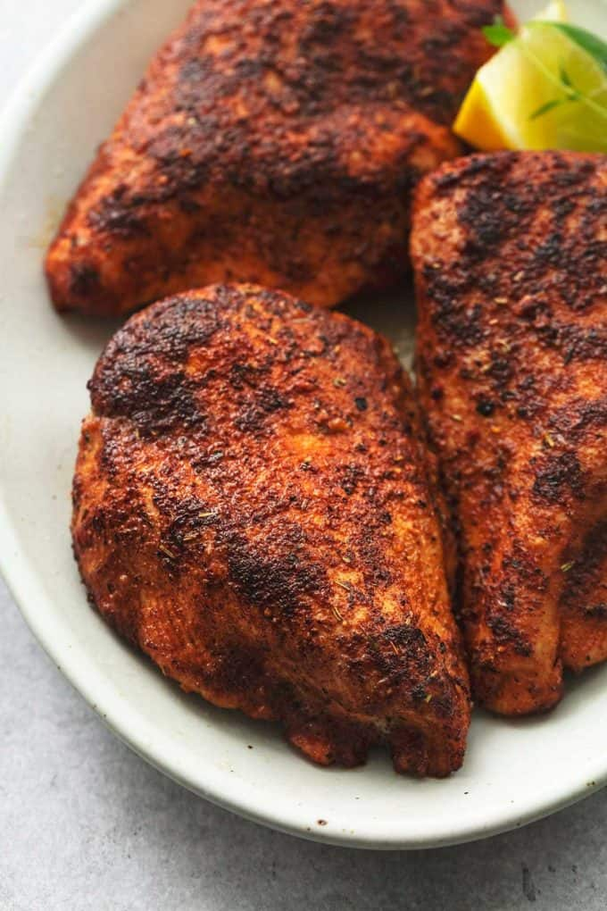 up close seasoned baked chicken on plate