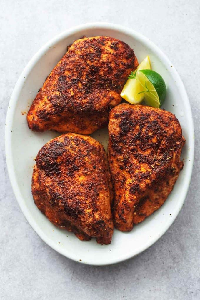 plate of three baked chicken breasts