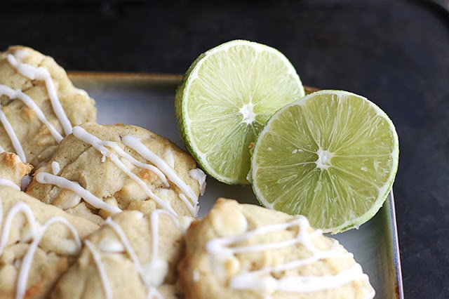 limes with cookies on square plate.