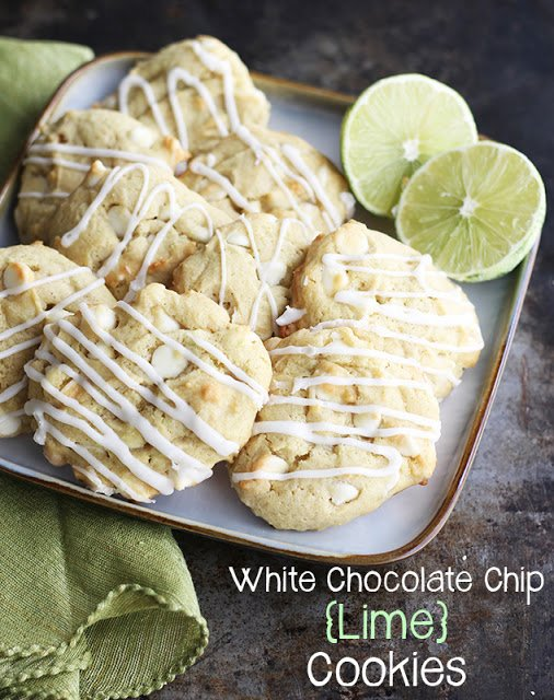 cookies on square plate with limes on top of a green napkin.